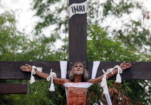 A Catholic devotee is nailed on a wooden cross during a ritual performed during Good Friday, in San Fernando City, Pampanga province, Philippines, April 19, 2019. REUTERS/Eloisa Lopez