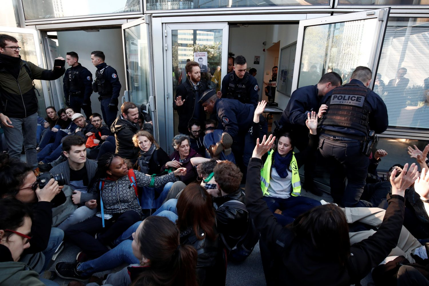 "Environmental activists block the entrance of the Ministry of Ecology, Energy and Sustainable Development during a ""civil disobedience action"" to urge world leaders to act against climate change, in La Defense near Paris, France, April 19, 2019. REUTERS/Benoit Tessier"