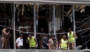 Crime scene officials inspect the explosion area at Shangri-La hotel in Colombo, Sri Lanka April 21, 2019. REUTERS/Dinuka Liyanawatte
