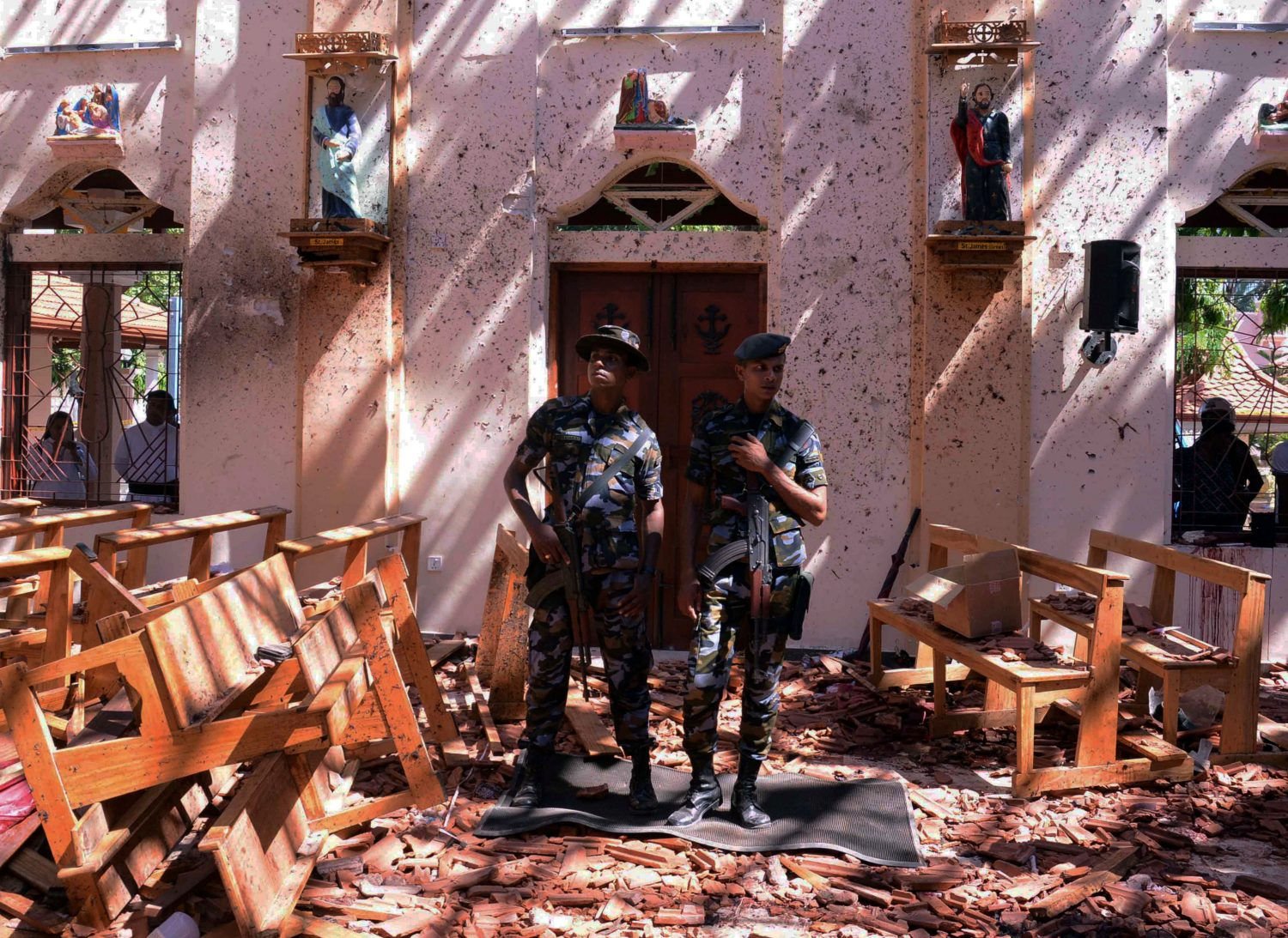 Sri Lankan military stand guard inside a church after an explosion in Negombo, Sri Lanka April 21, 2019. REUTERS/Stringer