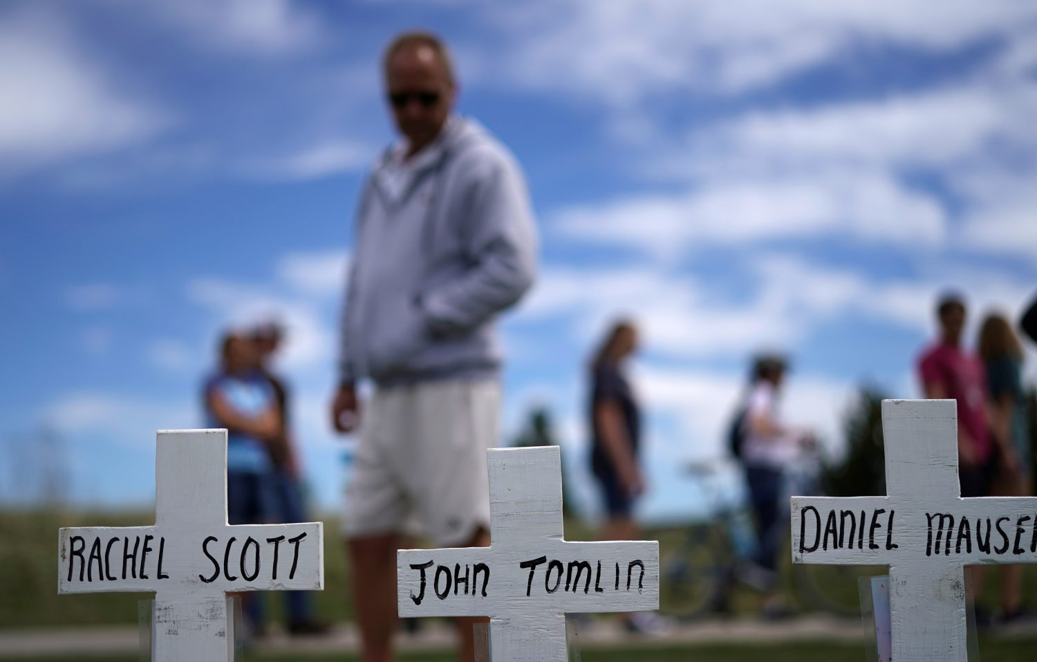 A man looks at a line of crosses commemorating those killed in the Columbine High School shooting on the 20th anniversary of the attack in Littleton, Colorado, U.S., April 20, 2019. REUTERS/Rick Wilking