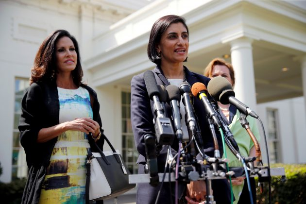 FILE PHOTO: U.S. Administrator of the Centers for Medicare and Medicaid Services (CMS) Seema Verma (C) is joined by Concerned Women for America CEO Penny Nance (L) at the White House in Washington, U.S., April 13, 2017. REUTERS/Jonathan Ernst/File Photo