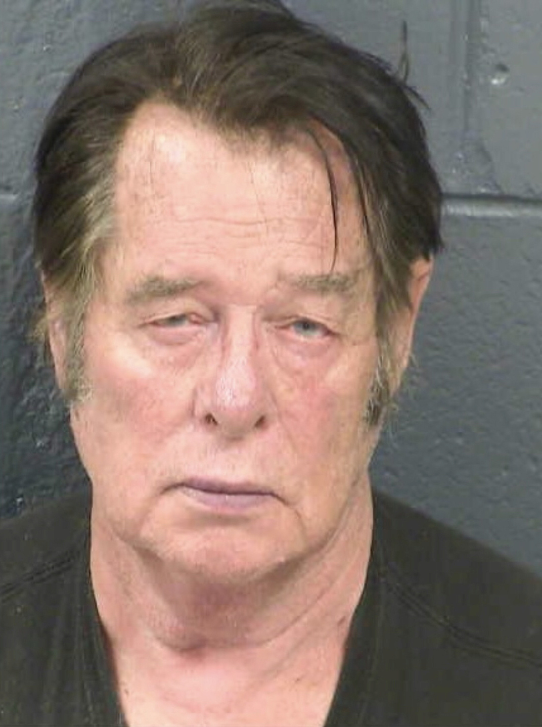 Larry Mitchell Hopkins appears in a police booking photo taken at the Dona Ana County Detention Center in Las Cruces, New Mexico, U.S., April 20, 2019. Dona Ana County Detention Center/Handout via REUTERS