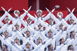 Chinese navy personnel perform at an event celebrating the 70th anniversary of the founding of the Chinese People's Liberation Army Navy (PLAN) in Qingdao, China, April 22, 2019. REUTERS/Jason Lee