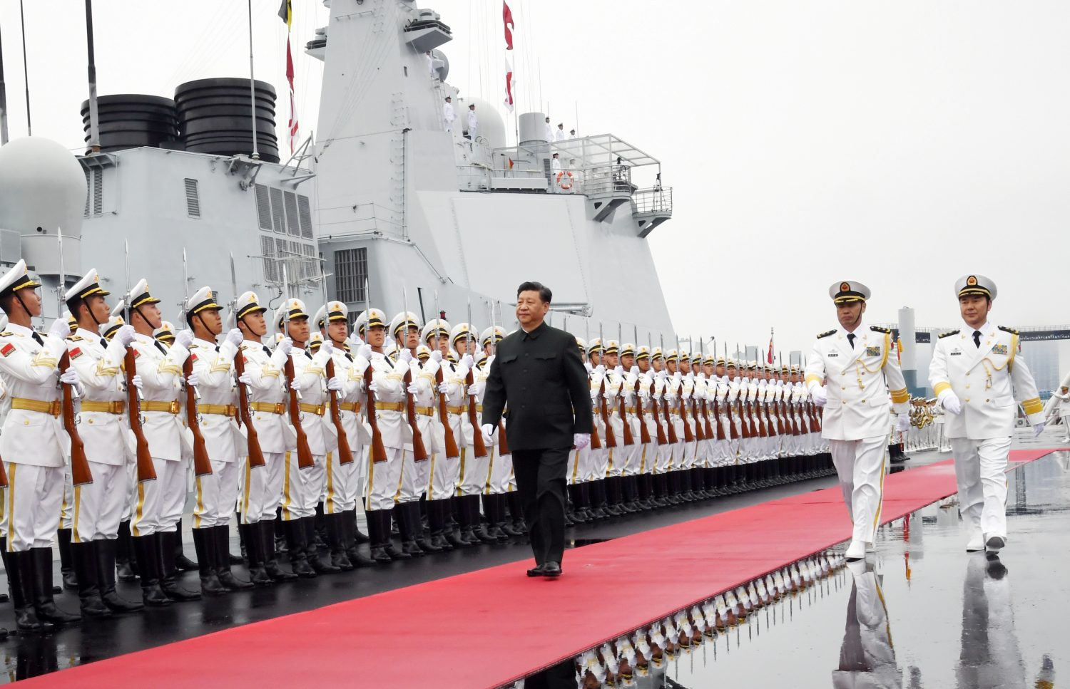 Chinese President Xi Jinping reviews the honor guards of the Chinese People's Liberation (PLA) Navy before boarding the destroyer Xining for the naval parade celebrating the 70th founding anniversary of the Chinese People's Liberation Army (PLA) Navy in Qingdao, Shandong province, China April 23, 2019. Xinhua via REUTERS