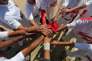 "Members of Family Rose softball team put their hands together before a match at Lecuna Avenue softball pitch in Caracas, Venezuela, March 24, 2019. ""After the game we always had a few beers. But now they are too expensive,"" said Felix Babaza. REUTERS/Ivan Alvarad"