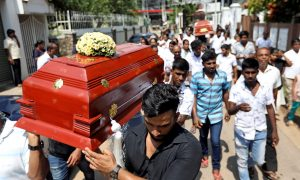 Friends and relatives carry the coffins of eight-month-old Mathew and his grandmother Agnes Vnikpridha, 69, who died during a string of suicide bomb attacks on churches and luxury hotels on Easter Sunday, at their funeral in Negombo, Sri Lanka April 24, 2019. REUTERS/Athit Perawongmetha