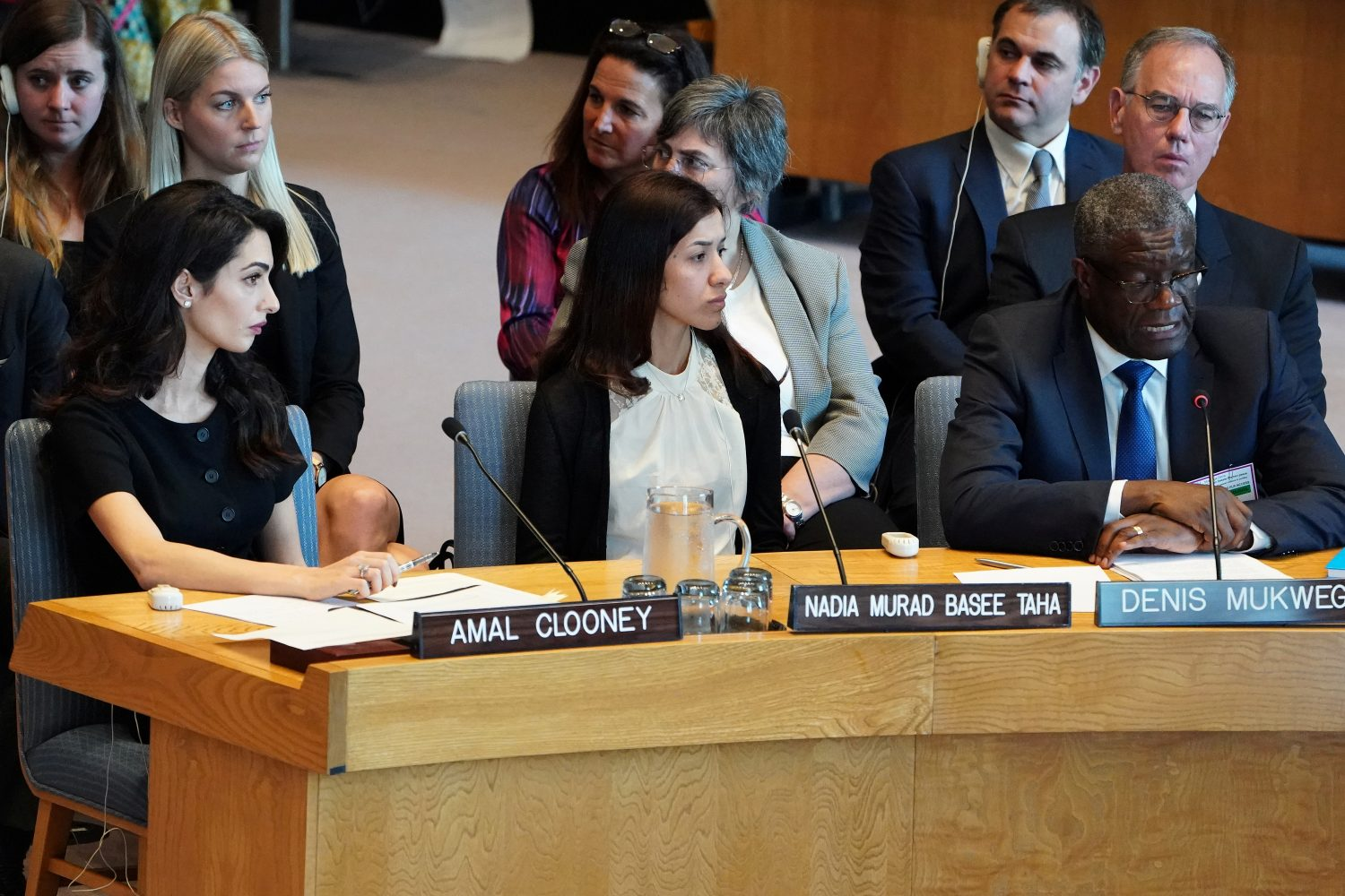Amal Clooney and Nadia Murad listen to Denis Mukwege speaking at the United Nations Security Council during a meeting about sexual violence in conflict in New York, New York, U.S., April 23, 2019. REUTERS/Carlo Allegri