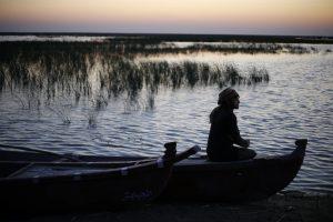 An Iraqi Marsh Arab man sits on a boat at the Chebayesh marsh in Dhi Qar province, Iraq April 13, 2019. REUTERS/Thaier al-Sudani