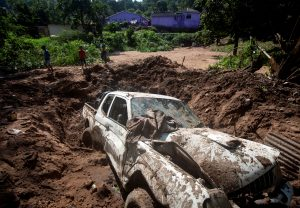 A wreckage of a vehicle remains after a body was recovered from under the mud after heavy rains caused by flooding in Marianhill near Durban, South Africa, April 25, 2019. REUTERS/Rogan Ward