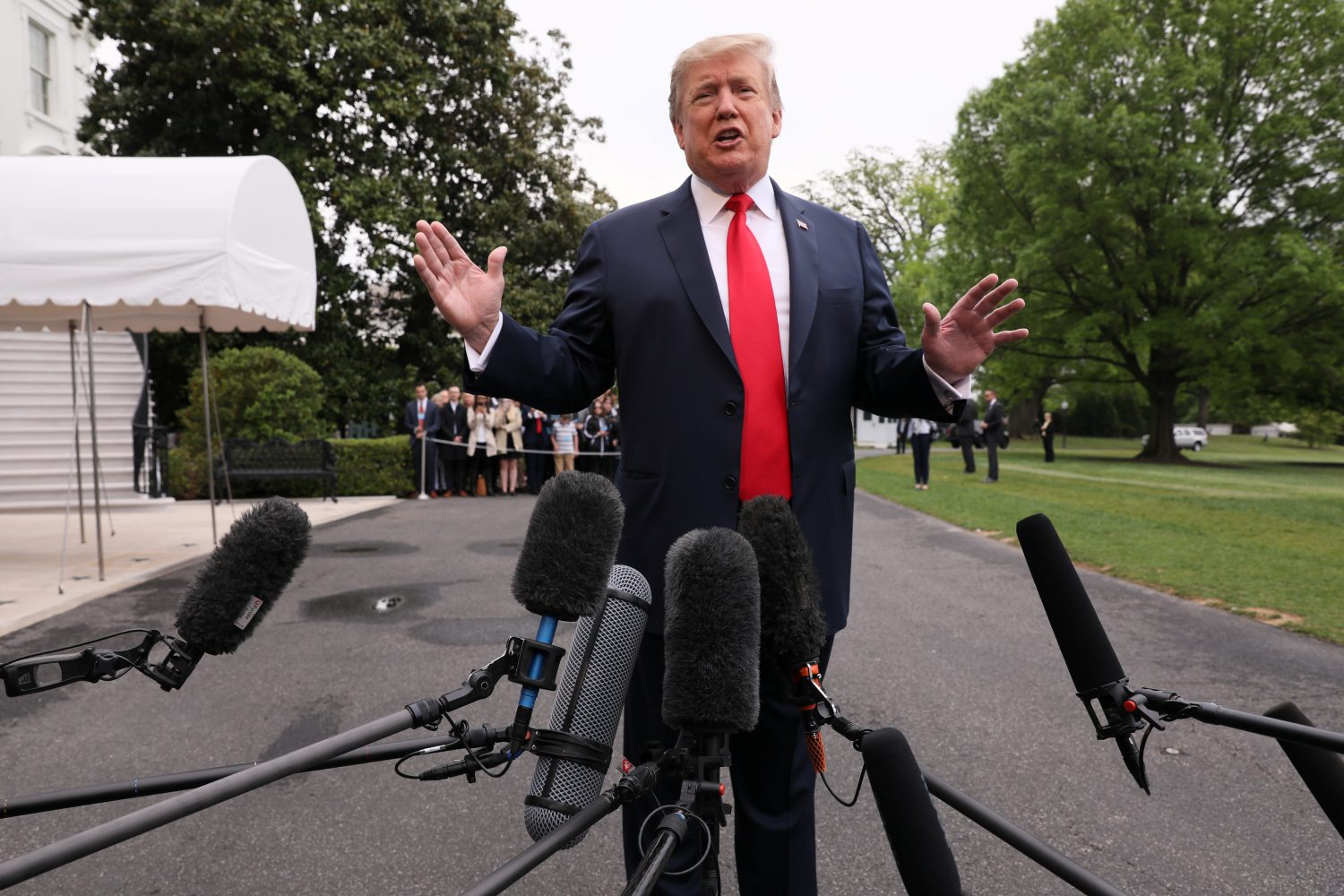 U.S. President Donald Trump talks to reporters as he departs for travel to Indianapolis, Indiana from the White House in Washington, U.S., April 26, 2019. REUTERS/Jonathan Ernst
