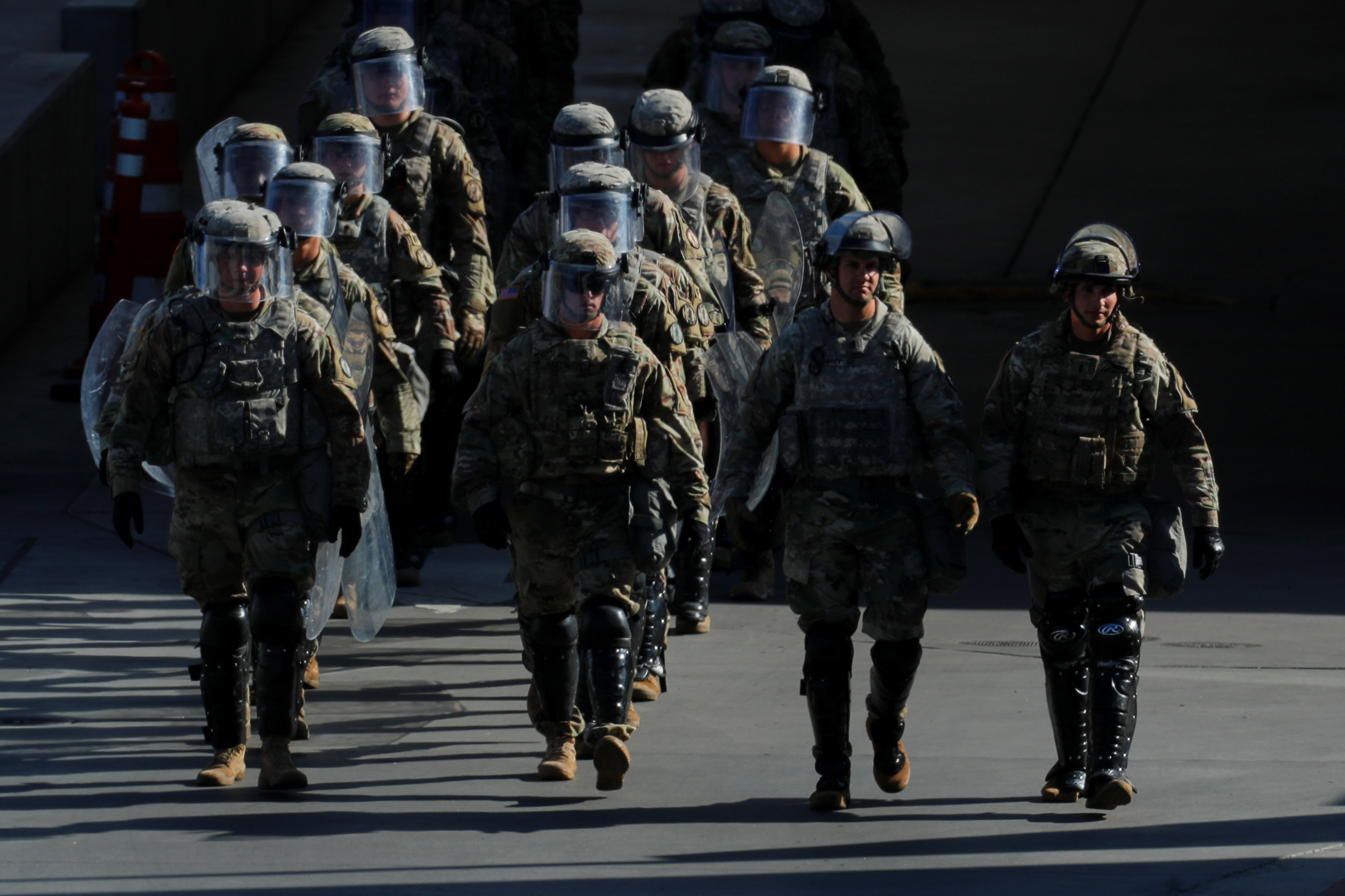 FILE PHOTO: U.S. Military troops return from a test deployment with U.S. Customs and Border Protection agents after conducting a large-scale operational readiness exercise at the San Ysidro port of entry with Mexico in San Diego, California, U.S., January 10, 2019. REUTERS/Mike Blake