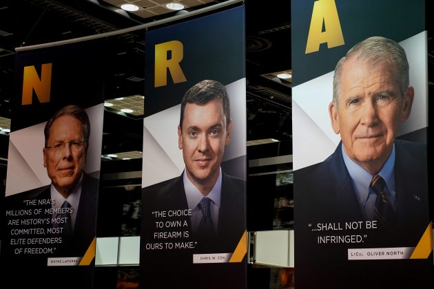 Images of NRA CEO Wayne LaPierre, Legislative Director Chris Cox and President Oliver North displayed during the National Rifle Association (NRA) annual meeting at the Indiana Convention center in Indianapolis, Indiana, U.S., April 27, 2019. REUTERS/Bryan Woolston