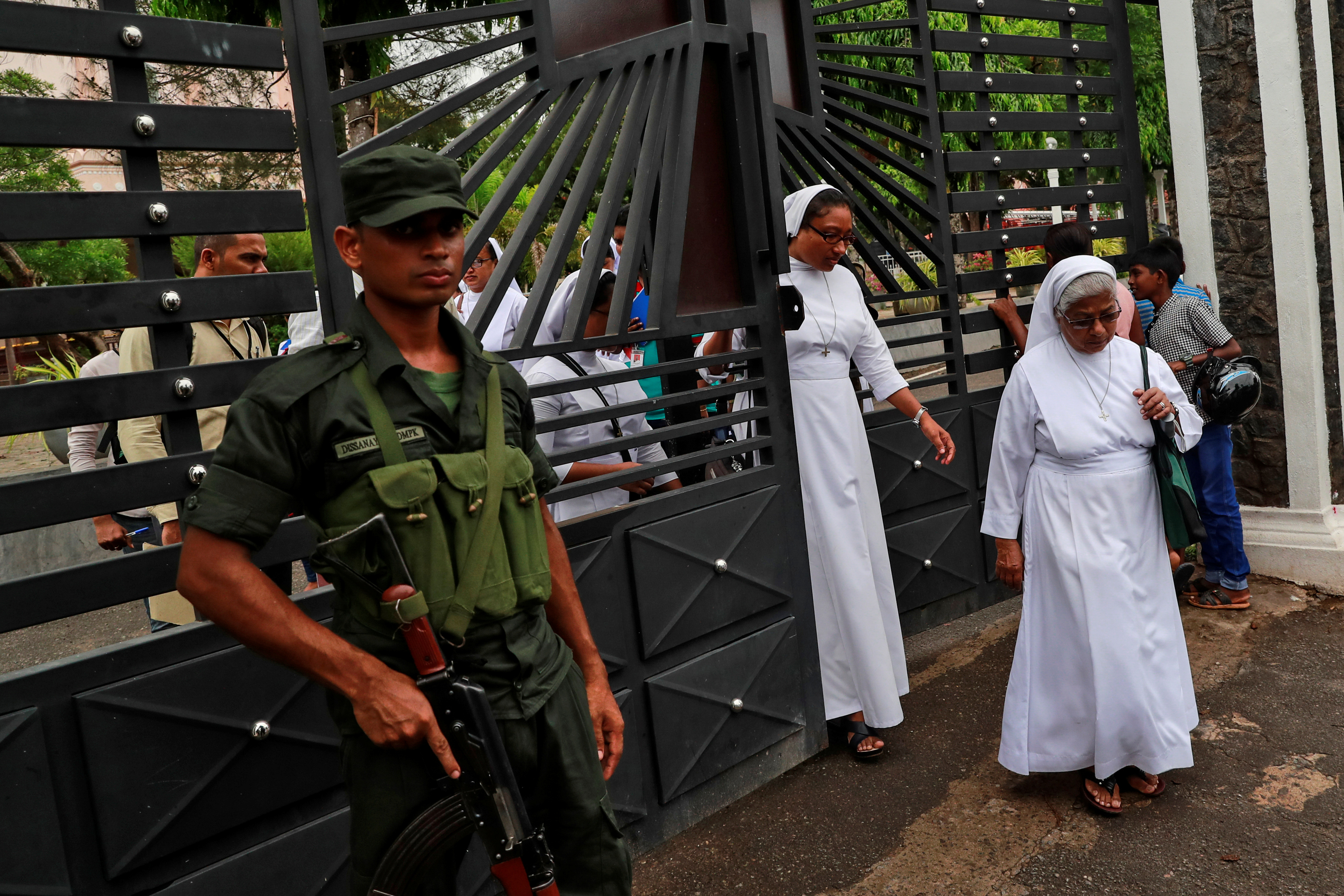 A soldier keeps guard as nuns walk out of St. Sebastian Church in Negombo, Sri Lanka, April 30, 2019. REUTERS/Danish Siddiqui