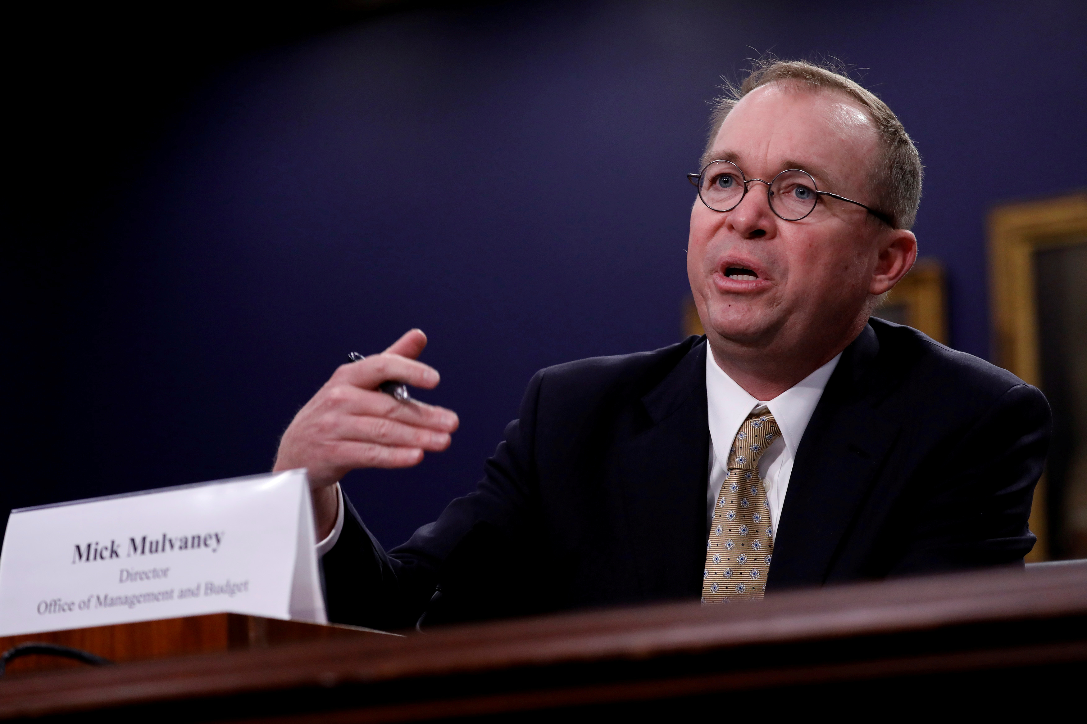 FILE PHOTO: Mick Mulvaney testifies before the House Appropriations Subcommittee on Financial Services and General Government on Capitol Hill in Washington, U.S., April 18, 2018. REUTERS/Aaron P. Bernstein/File Photo