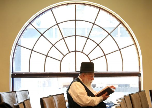 FILE PHOTO: A member of the Chabad of Midtown prays during a service for members of the Poway San Diego Chabad Synagogue, in New York, U.S., April 29, 2019. REUTERS/Brendan McDermid/File Photo