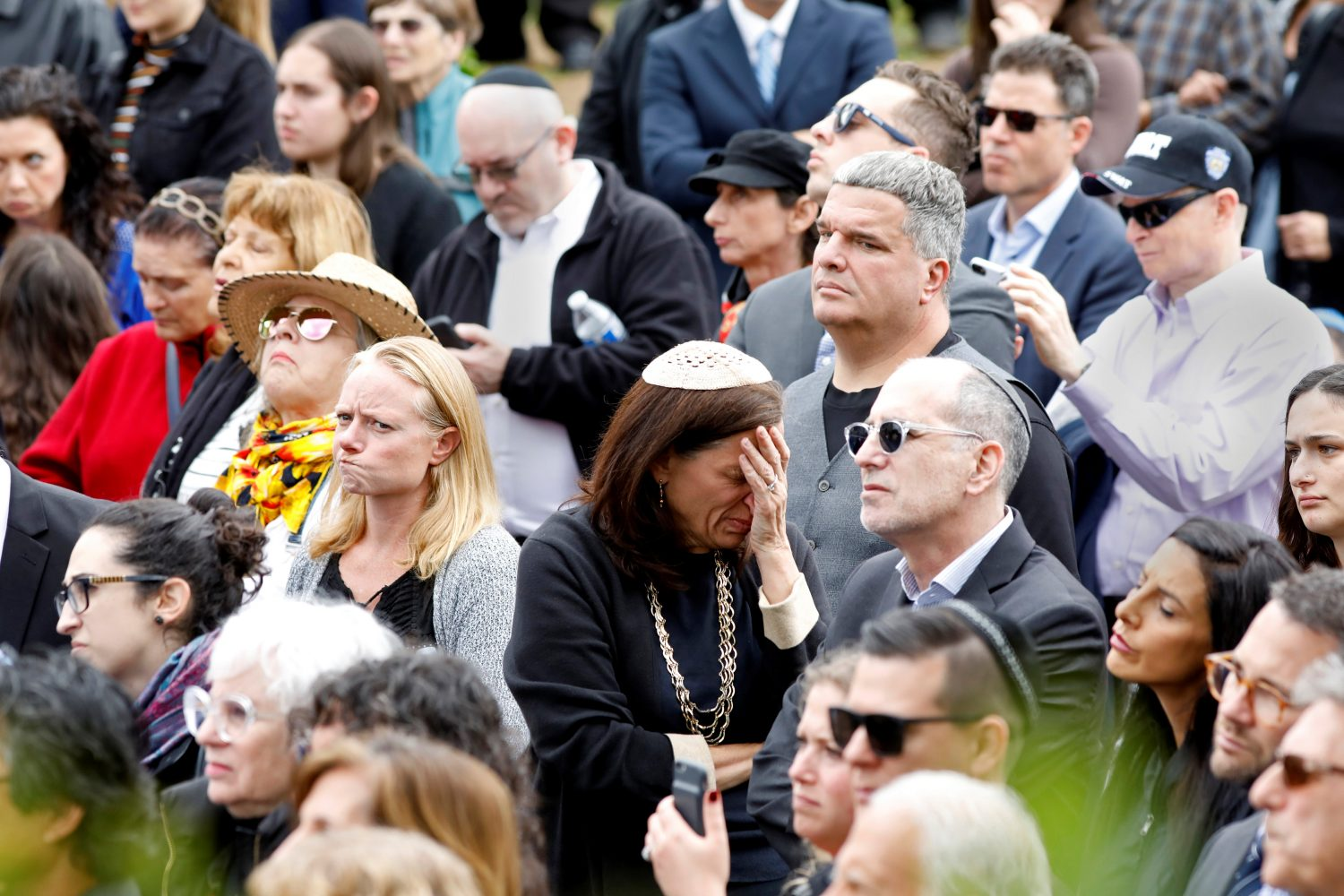 A crowd watches on screen the funeral for Lori Gilbert-Kaye, the sole fatality of the Saturday synagogue shooting at the Congregation Chabad synagogue in Poway, north of San Diego, California, U.S. April 29, 2019. REUTERS/John Gastaldo