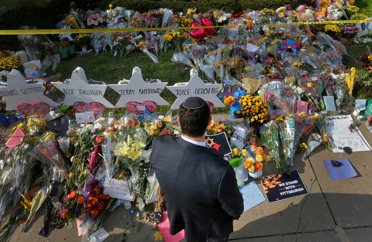 FILE PHOTO: A man prays at a makeshift memorial outside the Tree of Life synagogue following Saturday's shooting at the synagogue in Pittsburgh, Pennsylvania, U.S., October 31, 2018. REUTERS/Cathal McNaughton/File Photo