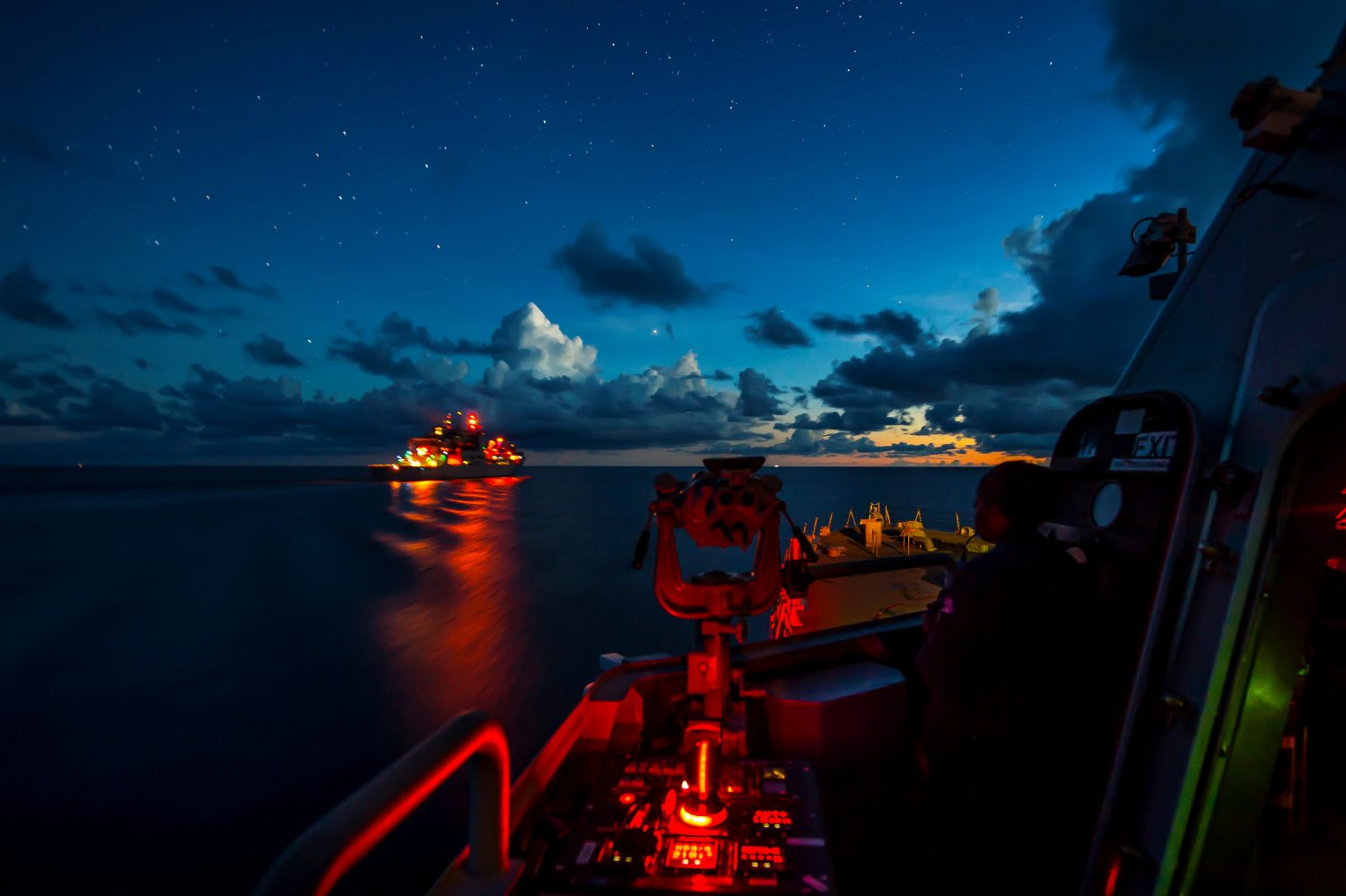 The littoral combat ship USS Fort Worth (LCS 3) prepares to transit alongside the Military Sealift Command dry cargo and ammunition ship USNS Wally Schirra (T-AKE 8) during a replenishment-at-sea during routine patrols in international waters of the South China Sea near the Spratly Islands May 9, 2015. U.S. Navy photo by Mass Communication Specialist 2nd Class Conor Minto/Handout via REUTERS