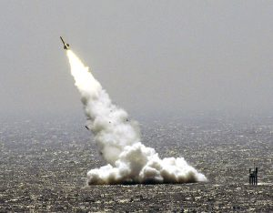 FILE PHOTO: A missile is launched from a Chinese submarine during a China-Russia joint military exercise in eastern China's Shandong peninsula, August 23, 2005. REUTERS/China Newsphoto/File Photo