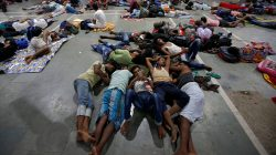 Stranded passengers rest inside a railway station after trains between Kolkata and Odisha were cancelled ahead of Cyclone Fani, in Kolkata, India, May 3, 2019. REUTERS/Rupak De Chowdhuri