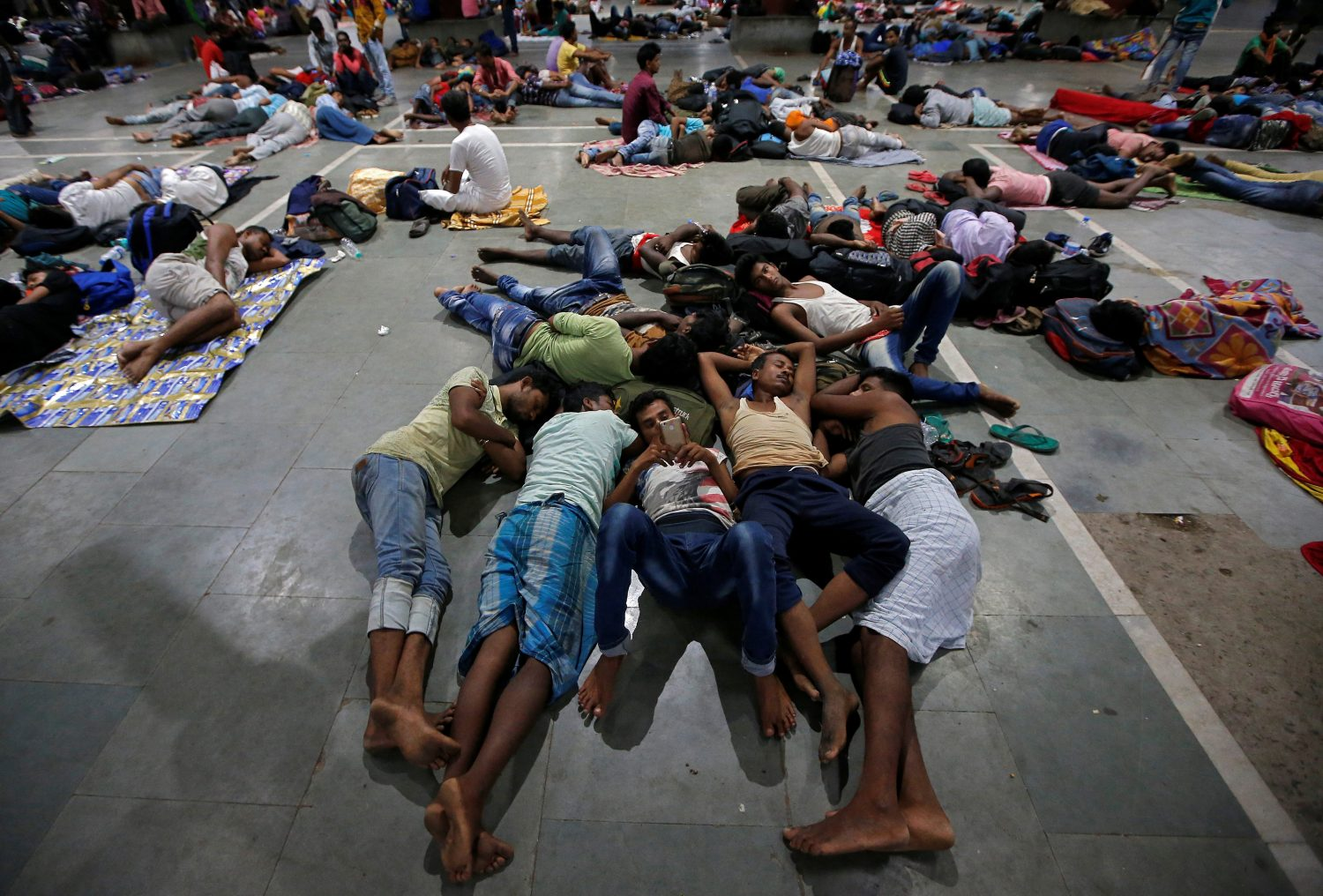 Stranded passengers rest inside a railway station after trains between Kolkata and Odisha were cancelled ahead of Cyclone Fani, in Kolkata, India, May 3, 2019. REUTERS/Rupak De Chowdhuri