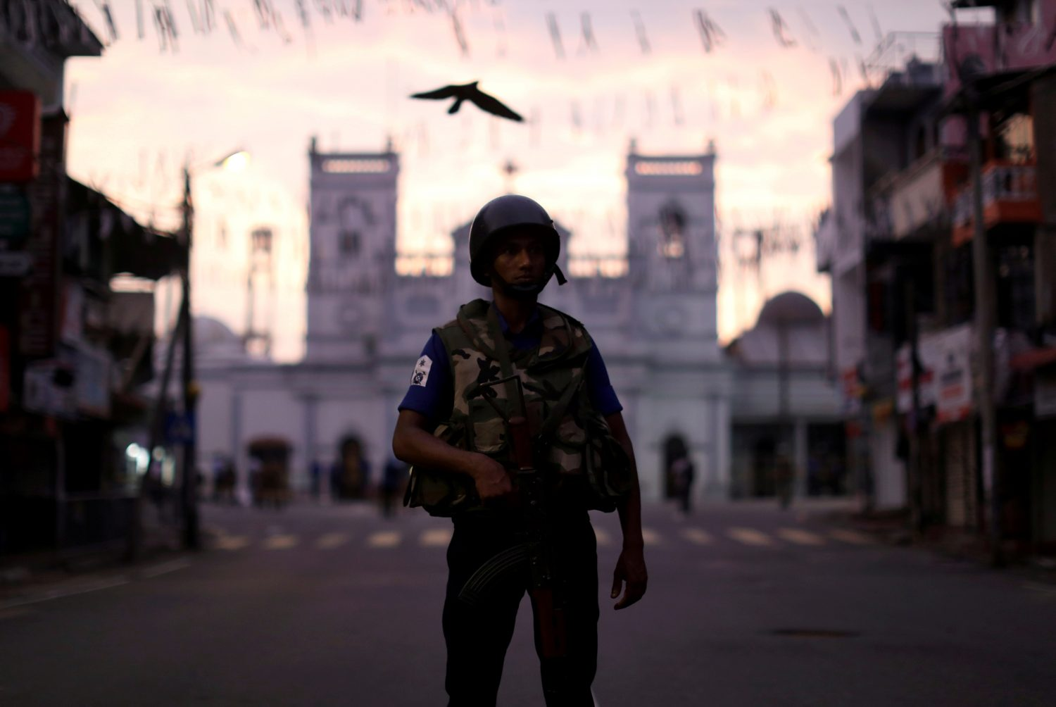 FILE PHOTO: A security officer stands guard outside St. Anthony's Shrine, days after a string of suicide bomb attacks on churches and luxury hotels across the island on Easter Sunday, in Colombo, Sri Lanka April 26, 2019. REUTERS/Athit Perawongmetha/File Photo