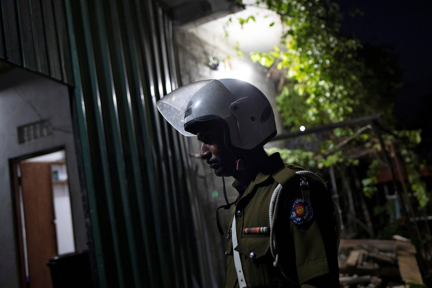 A police officer stands inside a training camp allegedly linked to Islamist militants, in Kattankudy near Batticaloa, Sri Lanka, May 5, 2019. REUTERS/Danish Siddiqui