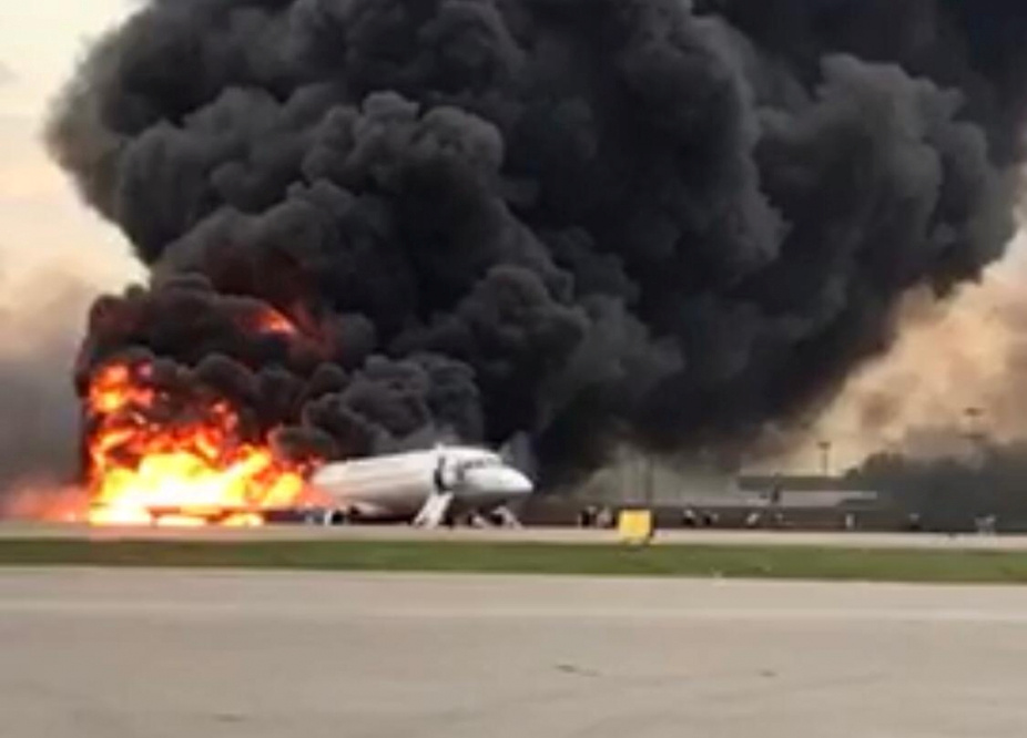 A passenger plane is seen on fire after an emergency landing at the Sheremetyevo Airport outside Moscow, Russia May 5, 2019. The Investigative Committee of Russia/Handout via REUTERS.