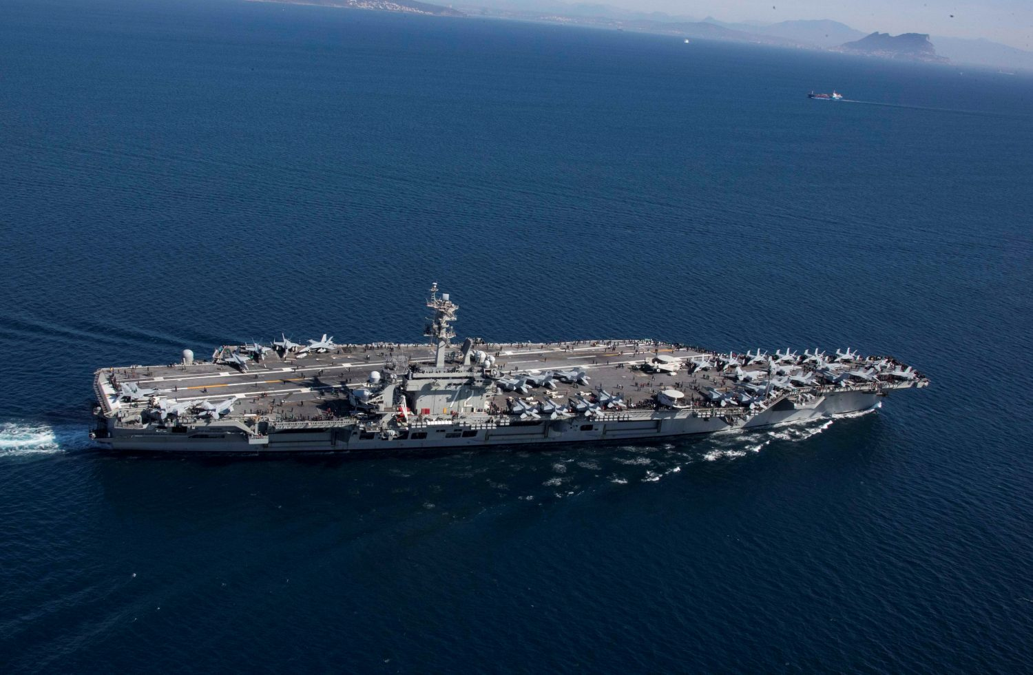The Nimitz-class aircraft carrier USS Abraham Lincoln (CVN 72) transits the Strait of Gibraltar, entering the Mediterranean Sea as it continues operations in the 6th Fleet area of responsibility in this April 13, 2019 photo supplied by the U.S. Navy. U.S. Navy/Mass Communication Specialist 2nd Class Clint Davis/Handout via REUTERS