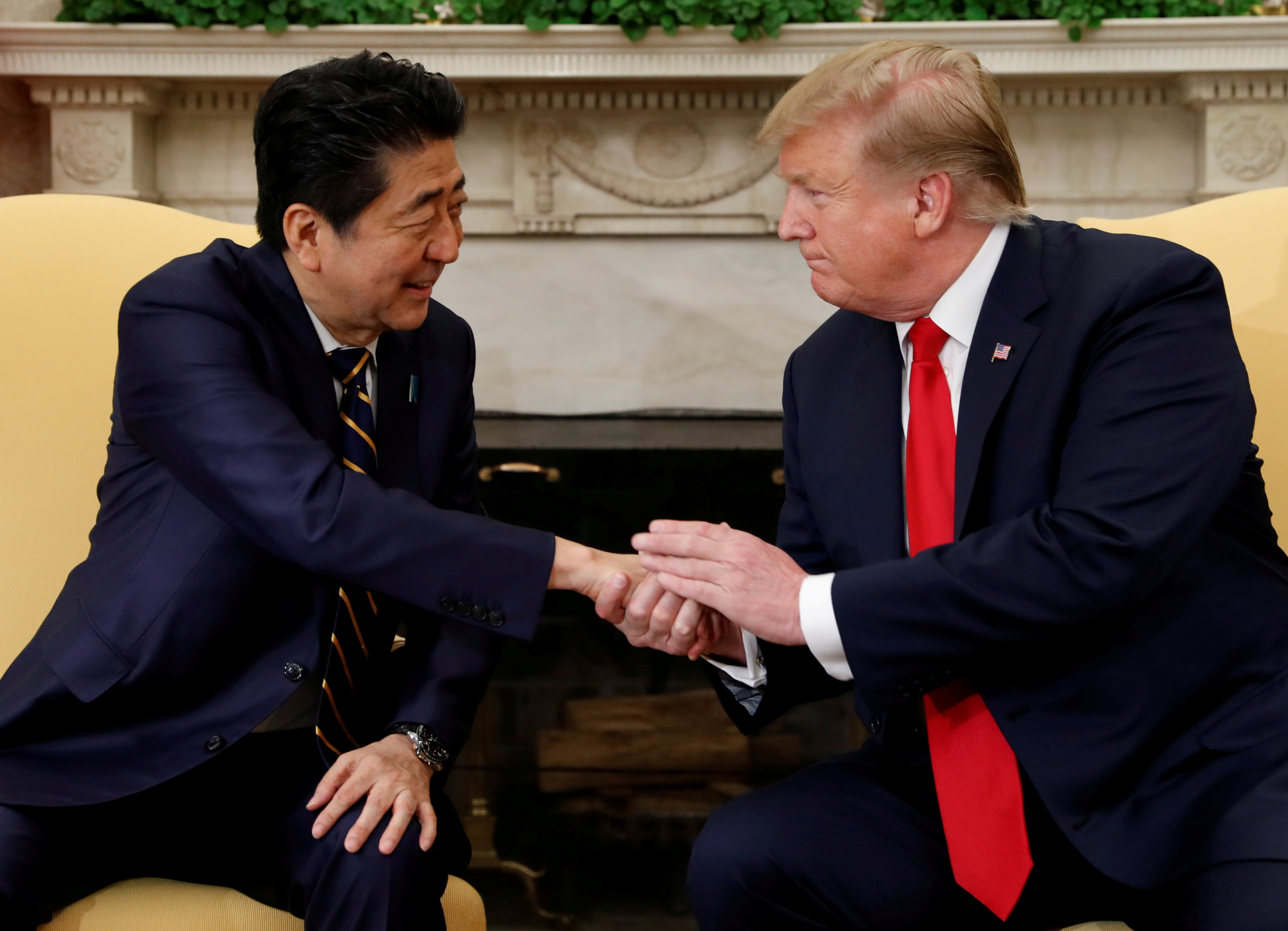 U.S. President Donald Trump meets with Japan's Prime Minister Shinzo Abe in the Oval Office at the White House in Washington, U.S., April 26, 2019. REUTERS/Kevin Lamarque