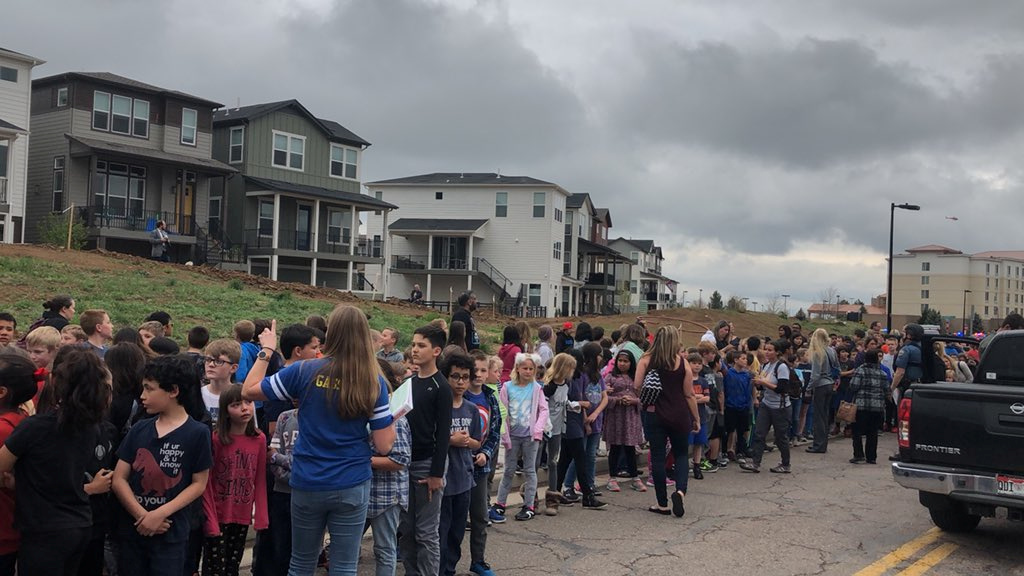 People wait outside near the STEM School during a shooting incident in Highlands Ranch, Colorado, U.S. in this May 7, 2019 image obtained via social media. SHREYA NALLAPATI/VIA REUTERS