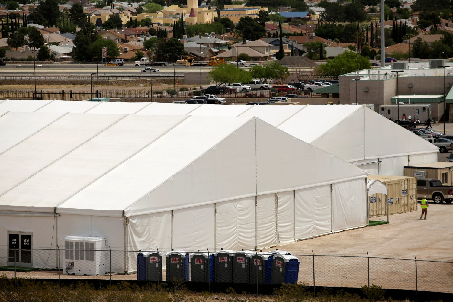 FILE PHOTO - A general view shows a temporary facility for processing migrants requesting asylum, at the U.S. Border Patrol headquarters in El Paso, Texas, U.S. April 29, 2019. REUTERS/Jose Luis Gonzalez