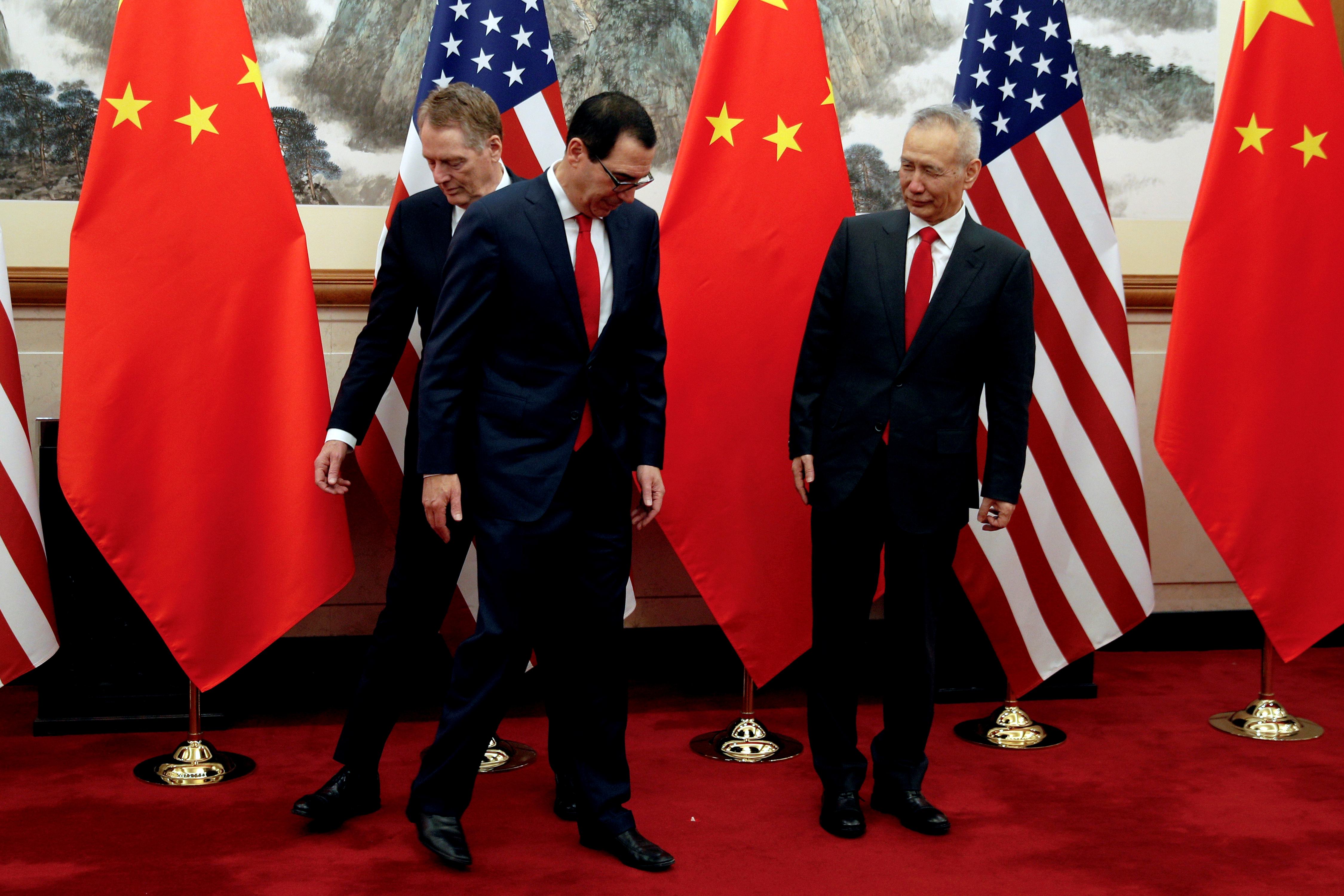FILE PHOTO: Chinese Vice Premier Liu He, right, looks as U.S. Treasury Secretary Steven Mnuchin, center, swaps places with his Trade Representative Robert Lighthizer during a photograph session before they proceed to their meeting at the Diaoyutai State Guesthouse in Beijing, Wednesday, May 1, 2019. Andy Wong/Pool via REUTERS