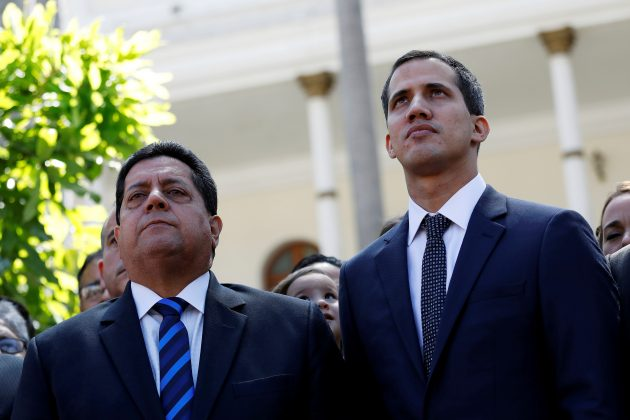 FILE PHOTO: Juan Guaido (R), new President of the National Constituent Assembly and lawmaker of the Venezuelan opposition party Popular Will (Partido Voluntad Popular), and lawmaker Edgar Zambrano of Democratic Action party (Accion Democratica), leave the congress after Guaido's swearing-in ceremony, in Caracas, Venezuela January 5, 2019. REUTERS/Manaure Quintero/File Photo