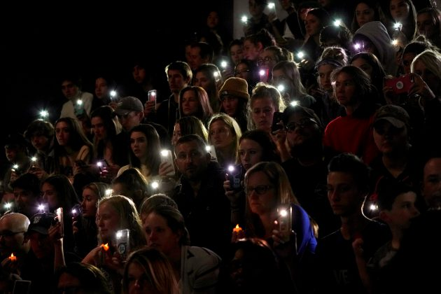People hold up the phone lights during a moment of silence at a vigil for the victims of the shooting at the Science, Technology, Engineering and Math (STEM) School in Highlands Ranch, Colorado, U.S., May 8, 2019 as U.S. Sen. Michael Bennett (D-CO) speaks. REUTERS/Rick Wilking