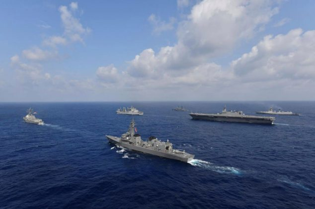 Vessels from the U.S. Navy, Indian Navy, Japan Maritime Self-Defense Force and the Philippine Navy sail in formation at sea, in this recent taken handout photo released by Japan Maritime Self-Defense Force on May 9, 2019. Japan Maritime Self-Defense Force/Handout via REUTERS