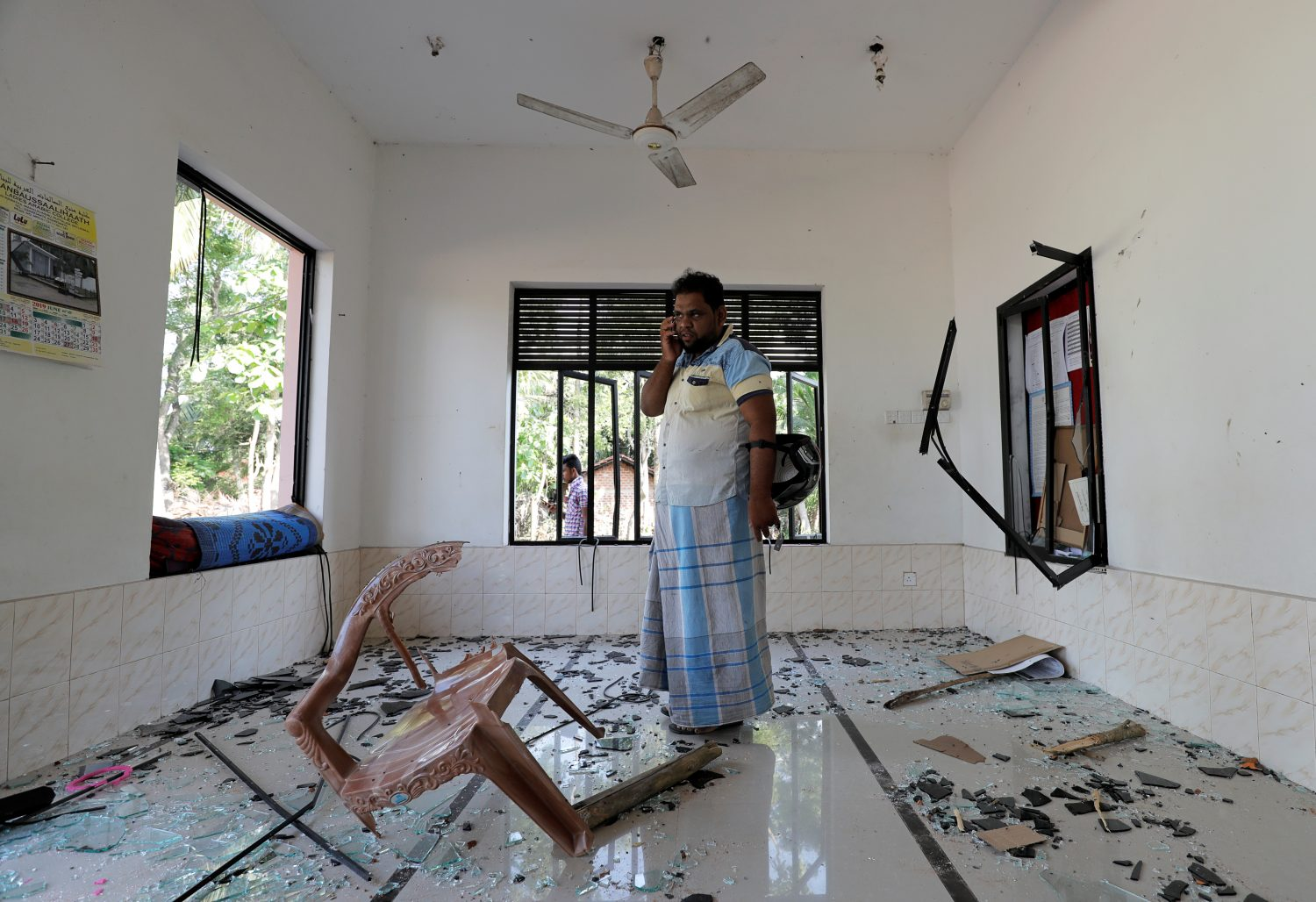 A Muslim man stands inside the Abbraar Masjid mosque after a mob attack in Kiniyama, Sri Lanka May 13, 2019. REUTERS/Dinuka Liyanawatte