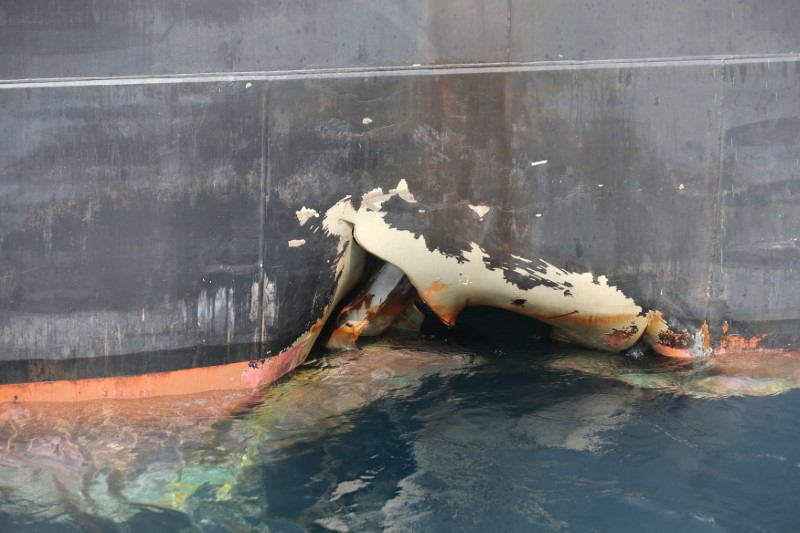 FILE PHOTO: A damaged ANDREA VICTORY ship is seen off the Port of Fujairah, United Arab Emirates, May 13, 2019. REUTERS/Satish Kumar