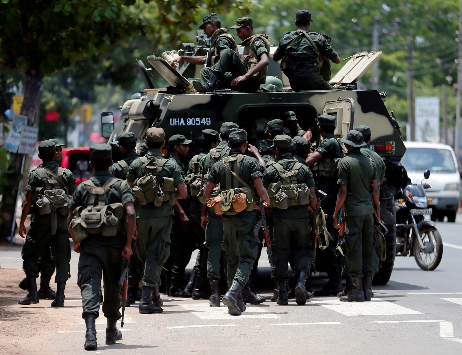 Sri Lankan soldiers patrol a road of Hettipola after a mob attack in a mosque in the nearby village of Kottampitiya, Sri Lanka May 14, 2019. REUTERS/Dinuka Liyanawatte