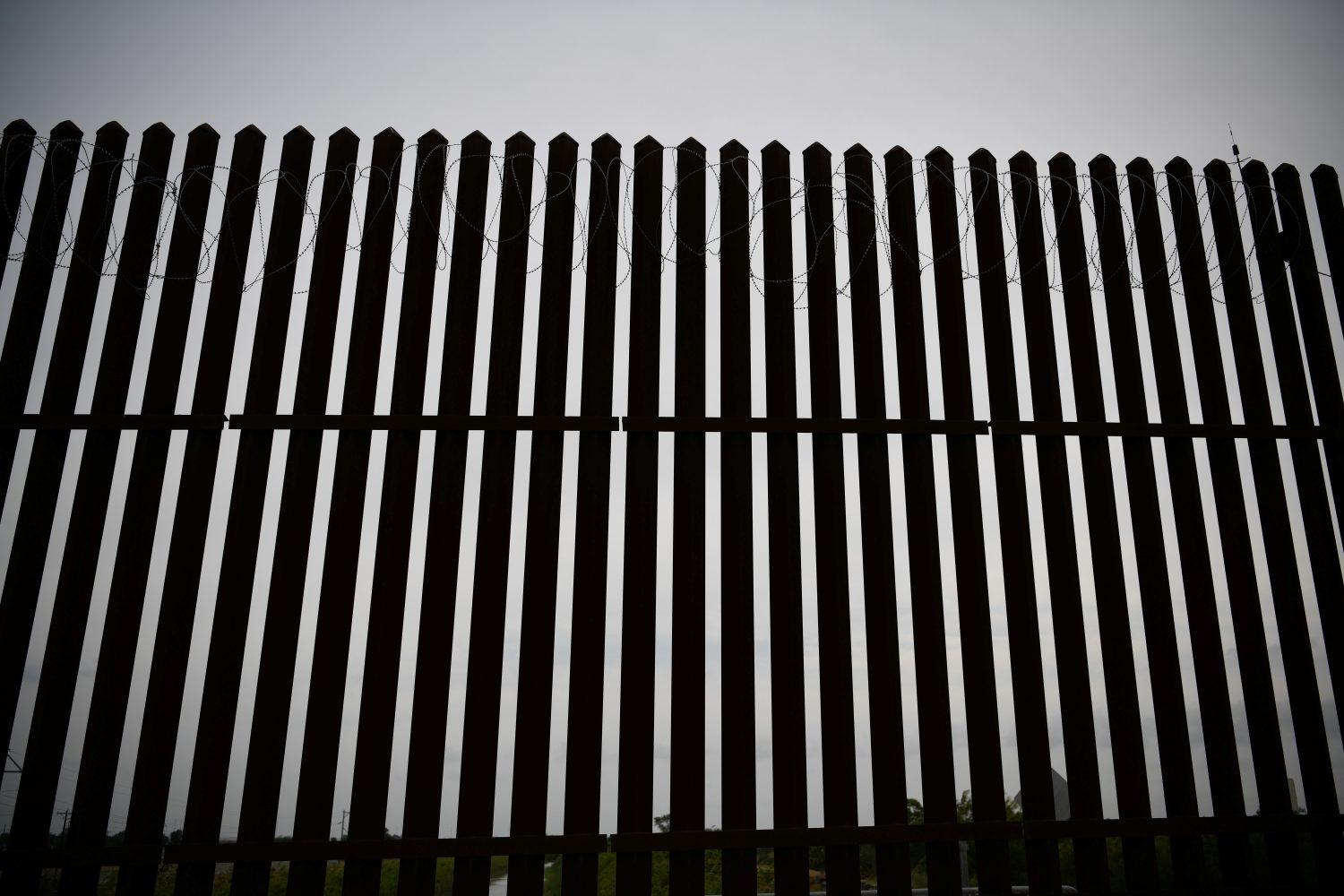 FILE PHOTO: Concertina wire is seen atop a section of border fence near the U.S.-Mexico border in Donna, Texas, U.S. May 2, 2019. REUTERS/Loren Elliott