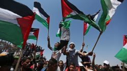 Demonstrators hold Palestinian flags during a protest marking the 71st anniversary of the 'Nakba', or catastrophe, when hundreds of thousands fled or were forced from their homes in the war surrounding Israel's independence in 1948, near the Israel-Gaza border fence, in the southern Gaza Strip May 15, 2019. REUTERS/Ibraheem Abu Mustafa