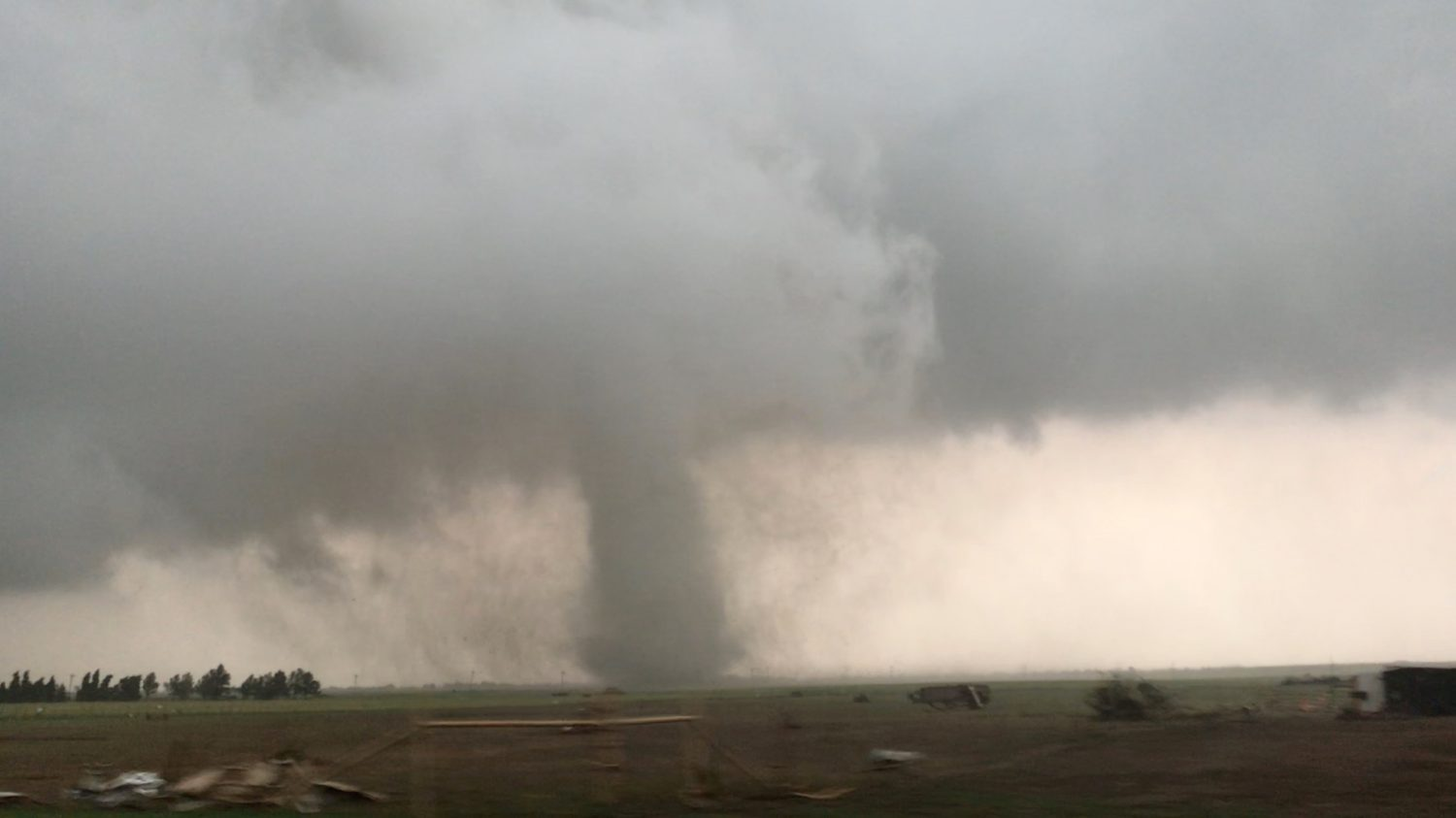 A tornado spins during stormy weather in Mangum, Oklahoma, U.S., May 20, 2019, in this still image taken from video from social media. Lorraine Matti via REUTERS