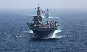 FILE PHOTO: The U.S. Navy amphibious assault ship USS Kearsarge and the Arleigh Burke-class guided-missile destroyer USS Bainbridge sail in the Arabian Sea May 17, 2019. U.S. Navy/Mass Communication Specialist 1st Class Brian M. Wilbur/Handout via REUTERS.