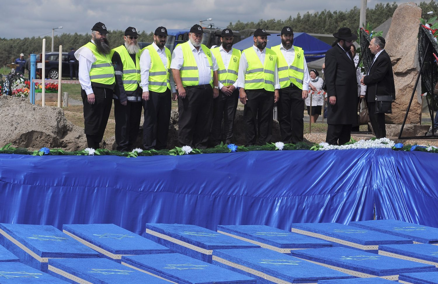 People attend a ceremony to rebury the remains of Jews killed by Nazis in a local ghetto during World War Two, which were recently found at a construction site in a residential area, in the city of Brest, Belarus May 22, 2019. REUTERS/Stringer