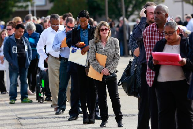 FILE PHOTO: People wait in line to enter the Nassau County Mega Job Fair at Nassau Veterans Memorial Coliseum in Uniondale, New York October 7, 2014. REUTERS/Shannon Stapleton/File Photo