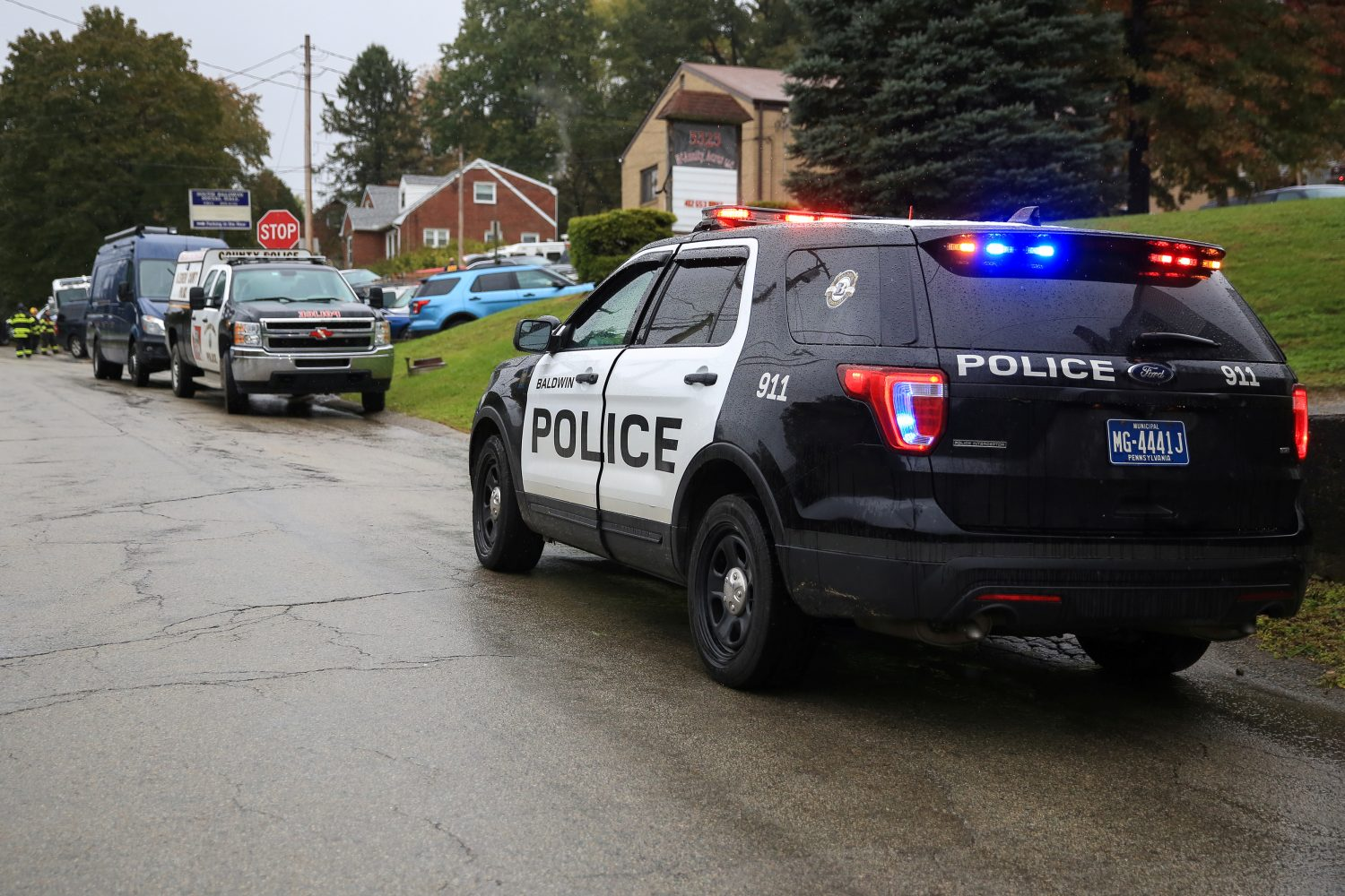 Police vehicles are deployed near the vicinity of the home of Pittsburgh synagogue shooting suspect Robert Bowers' home in Baldwin borough, suburb of Pittsburgh, Pennsylvania, U.S., October 27, 2018. REUTERS/John Altdorfer