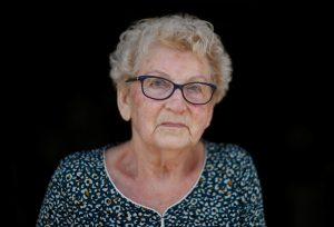 Marthe Rigault, 87 years old, from Graignes in the Normandy region poses as she attends an interview with Reuters in Graignes, France May 15, 2019. Picture taken May 15, 2019. REUTERS/Christian Hartmann