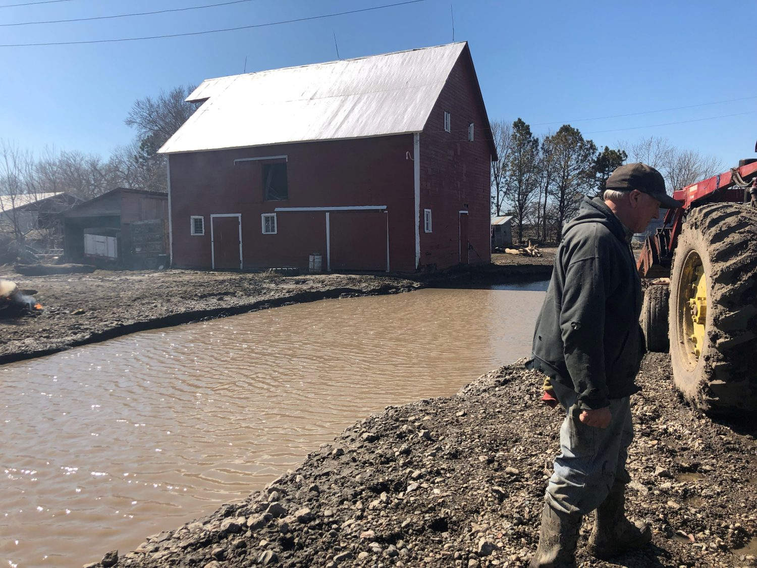 FILE PHOTO: Tom Geisler surveys damaged to his farm, following flooding in Winslow, outside Omaha, Nebraska, U.S., March 20, 2019. REUTERS/Humeyra Pamuk/File Photo