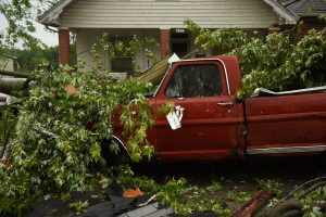 A damaged car is parked on Woodlawn Avenue following a tornado touchdown overnight in Jefferson City, Missouri, U.S. May 23, 2019. REUTERS/Antranik Tavitian